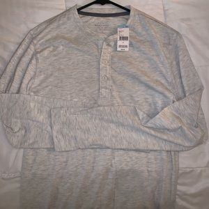 Roebuck, grey long sleeve shirt with buttons.
